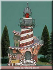 56.13202 rudolphs red-nosed lighthouse a storybook village cartoon characters